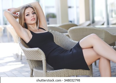 e17e602dc269 beautiful attractive woman wearing short and high heels standing in the  street in urban model scene