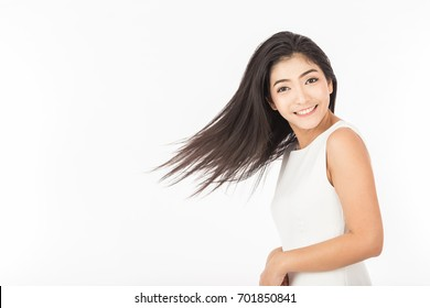 Beautiful Attractive young Asian woman flick head to showing smooth hair feeling so happiness,Isolated on white background,Haircare Concept