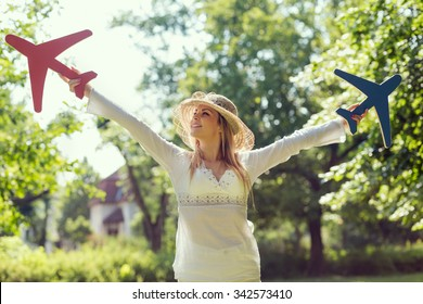 Beautiful attractive young woman having fun, daydreaming and enjoying in the park on a sunny summer day
