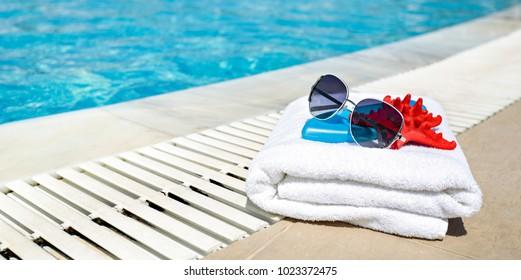 beautiful aura over the pool and a bath towel