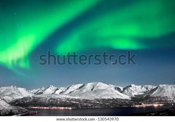 Beautiful Aurora above fjords near Skibotn, Norway