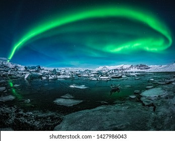 A beautiful aurora appeared above the glacier lake in Iceland.