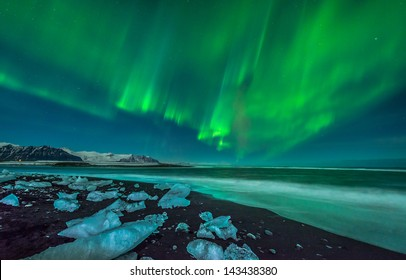 A beautiful aurora display over the ice beach near Jokulsarlon, Iceland.