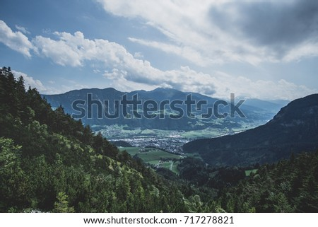 Beautiful Austrian town between the mountains under a cloudy sky