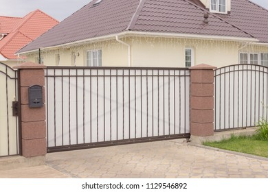 Beautiful automatic sliding gate in white color in a private house
