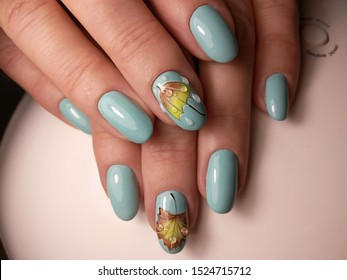 Beautiful autumn blue manicure with umbrella and leave pictures