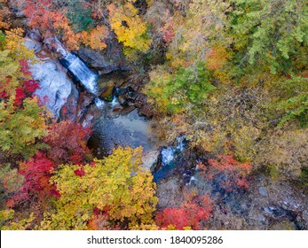 Beautiful autumn colors of Gangwondo aerial view, South Korea. This is the waterfall in a Mountain called Bantaesan. Image was captured from DJI Mavic Air2.