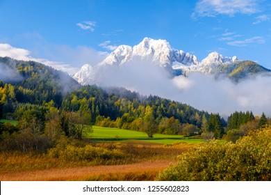 Beautiful autumn colors at the lake Zelenci in the background the Martuljek mountain near the  Kranjska  Gora at Triglav national park  in Slovenia,Europe