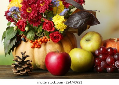 Beautiful autumn composition on table on bright background