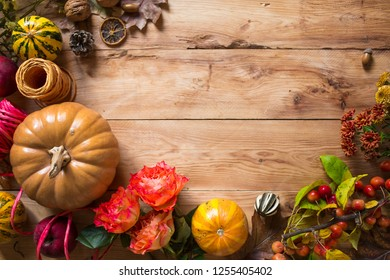 beautiful autumn composition with a pumpkin  on the wooden table