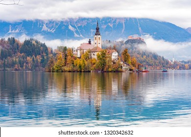 Beautiful autumn landscape around Lake Bled with Pilgrimage Church of the Assumption of Maria at Slovenia