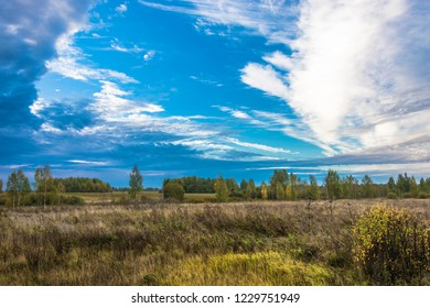 Beautiful autumn landscape with fields, forests and cloudy skies in the early morning, Russia.