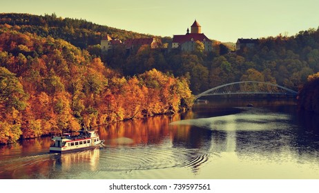 Beautiful Autumn Landscape with Veveri Castle. Natural colorful scenery with sunset. Brno dam-Czech Republic-Europe.