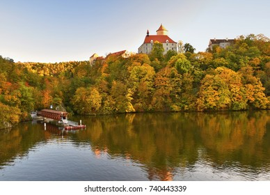 Beautiful Autumn Landscape with Veveri Castle. Natural colorful scenery with sunset. Brno dam, Czech Republic - Europe.