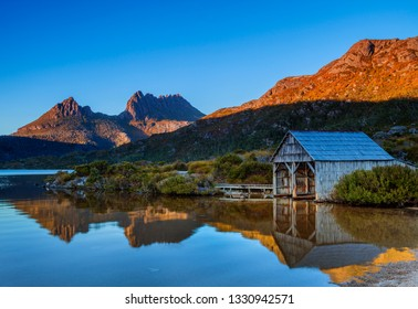Beautiful autumn morning at Dove Lake.Reflections of Cradle mountain and Boat Shed in lake.Cradle Mountain Lake St Clair National Park.Central Highlands of Tasmania,Australia.