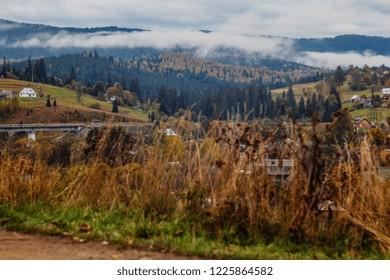 beautiful autumn mountain and small village on mountainside (Carpathian. Ukraine)