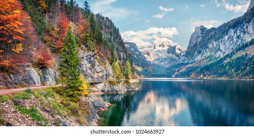 Beautiful autumn panorama of Vorderer ( Gosausee ) lake with Dachstein glacier on background. Splendid morning view of Austrian Alps, Upper Austria, Europe. Orton Effect.