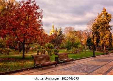 Beautiful autumn park Volodymyrska Hirka or Saint Volodymyr Hill at sunrise, Kyiv (Kiev), Ukraine. Scenic sunny landscape