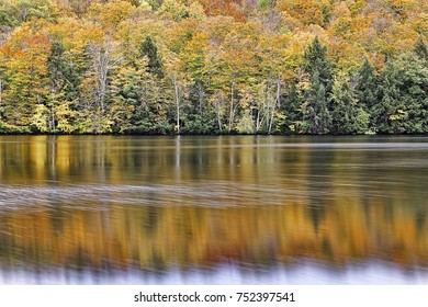 Beautiful Autumn reflections on the Madawaska River, just outside the village of Burnstown, Ontario, in the heart of the Ottawa Valley.