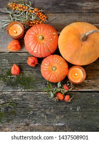 beautiful autumn scene with pumpkins. autumn cozy still life. pumpkins, autumn leaves, candles on wooden background. fall season, thanksgiving holiday, Halloween concept. copy space