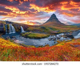 Beautiful autumn scenery. Colorful morning view of popular tourast destination - Kirkjufellsfoss Waterfall. Stunning autumn sunrise on Snaefellsnes peninsula, Iceland, Europe.