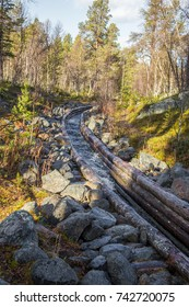 A beautiful autumn scenery of a historic water channel for transporting timber between lakes. Wooden construction.  Autumn in Femundsmarka National Park.