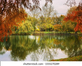 Beautiful autumn scenery and reflection over the lake in the University of Surrey campus in Guildford, Surrey, United Kingdom