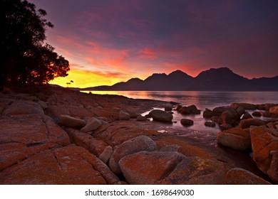 Beautiful autumn sunrise over Coles Bay.The Hazards mountain range in the distance.Freycinet National Park.East Coast of Tasmania,Australia.