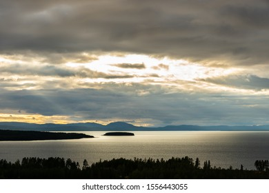 Beautiful autumn sunset cloudscape view of lake Siljan in Dalarna Sweden. Forest, water and land in the foreground.