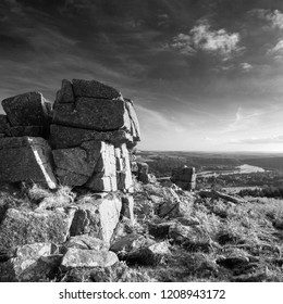 Beautiful Autumn sunset landscape image of view from Leather Tor towards Burrator Reservoir in Dartmoor National Park in black and white