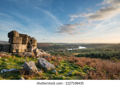 Beautiful Autumn sunset landscape image of view from Leather Tor towards Burrator Reservoir in Dartmoor National Park