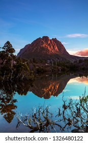 Beautiful autumn sunset over Twisted Lakes with Cradle Mountain in the background.Cradle Mountain Lake St Clair National Park.Central Tablelands of Tasmania,Australia.