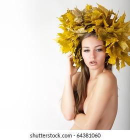 Beautiful autumn women. At the woman an autumn wreath on a head.