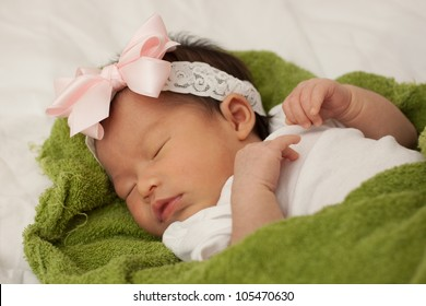 Beautiful Baby Asian Infant Girl Sleeping on Green Blanket