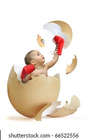 Beautiful baby breaking the egg shell isolated in white