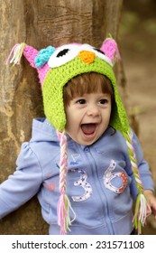 Beautiful baby girl  is in the little cap of owl