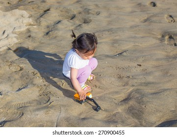 Beautiful baby girl on the beach, Asian girl