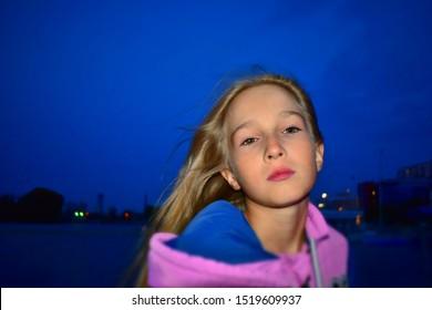Beautiful baby girl on night city background.
