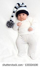 Beautiful baby in knitted hat