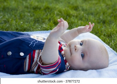 Beautiful baby lies on a coverlet