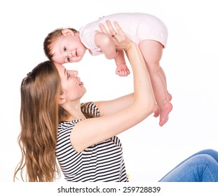 Beautiful baby and mother playing isolated on white