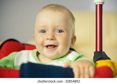 beautiful baby on the swings portrait
