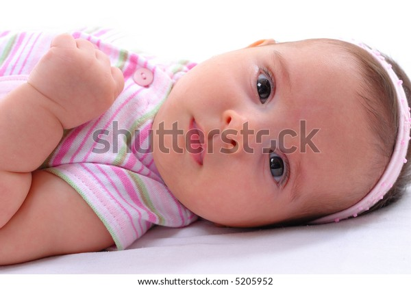 Beautiful Baby portrait on white bed .