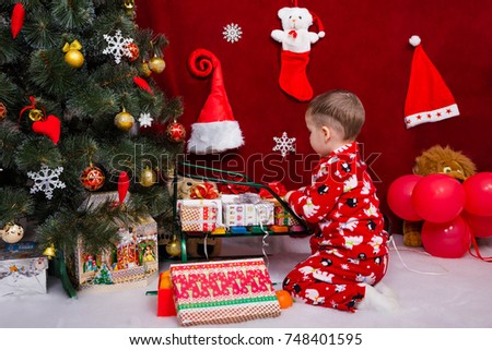 a0916fae25cb Beautiful Baby Puts Christmas Presents On Stock Photo (Edit Now ...