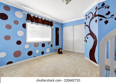 Beautiful baby room interior with cheerful murals on bright blue walls