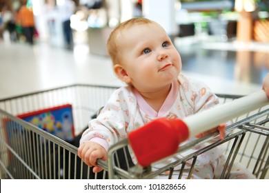 Beautiful baby in shopping cart - trolley