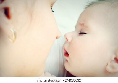 Beautiful baby sleeping on mother hands