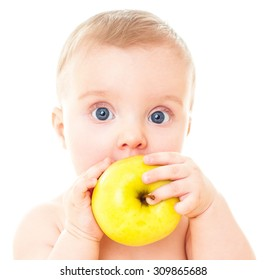 Beautiful baby with yellow apple. Baby eating healthy food isolated.