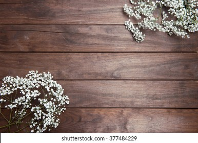 beautiful baby's breath on wooden background