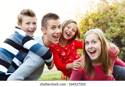 Beautiful babysitter having fun with the children.